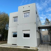 Modular container building in light grey