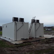 White 20ft shipping containers with airco as technical area
